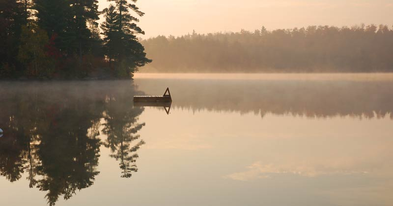 calm Canadian lake early morning