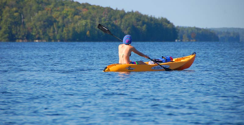 kayaker on a lake in Ontario, Canada