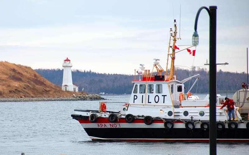 Lighthouse and harbour pilot boat in Halifax