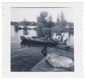 motorboat at a dock, West Hawk Lake, Manitoba