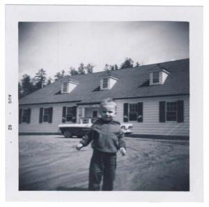 child in front of West Hawk fish hatchery