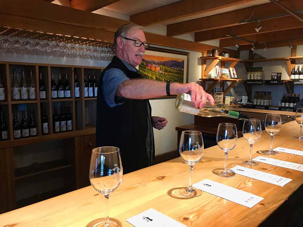 Hillside Winery owner Duncan McCowan offers wine for tasting