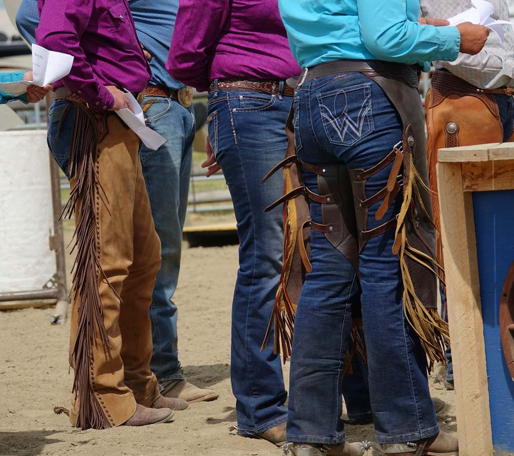 Wrangler jeans leather chaps cowboy buckles at Bar U Ranch National Historic Site